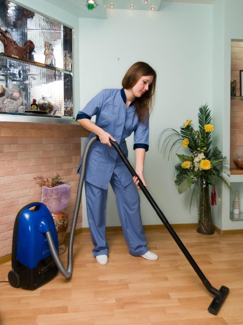 Sugar Land maid vacuuming floor